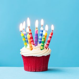 A cupcake with birthday candles
